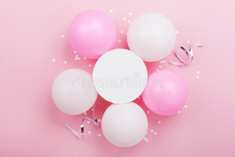 Birthday mockup with white paper list, confetti and pastel balloons on pink table top view. Flat lay composition. Birthday mockup with white paper list stock images