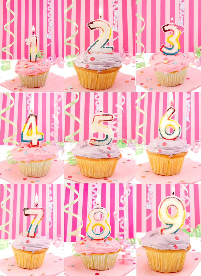 Birthday number cupcakes. Pink frosted birthday decorated cupcakes with lit candles from 1 to 9 stock photo