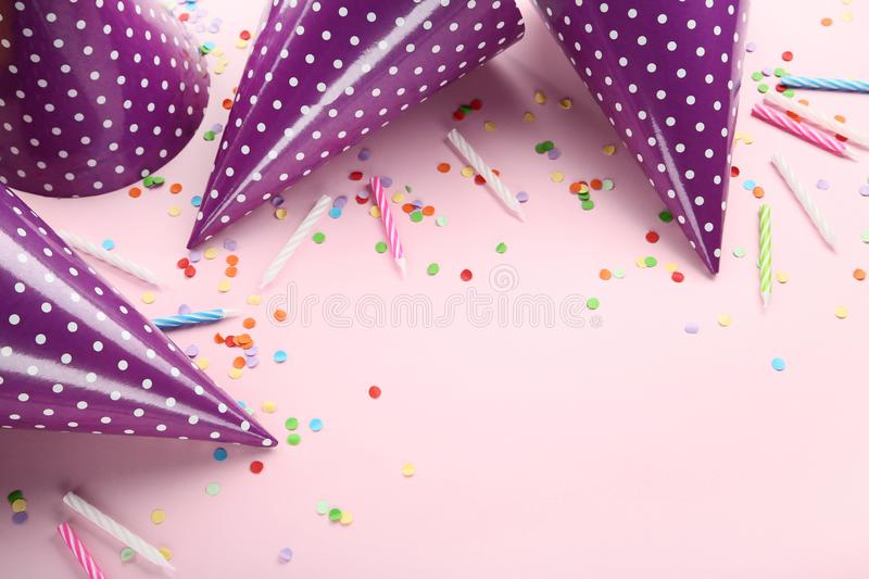 Birthday paper caps with candles royalty free stock photos