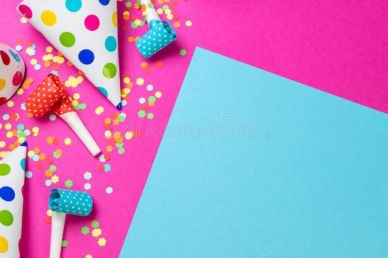 Birthday paper caps with candles and straws on blue background stock photo