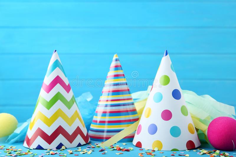Birthday paper caps with confetti royalty free stock images