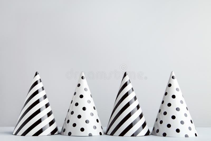 Birthday paper caps. On grey background royalty free stock images