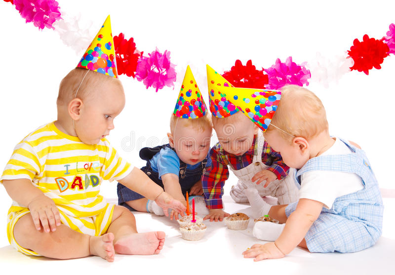 Birthday party. Four lovely toddlers at the birthday party royalty free stock photo
