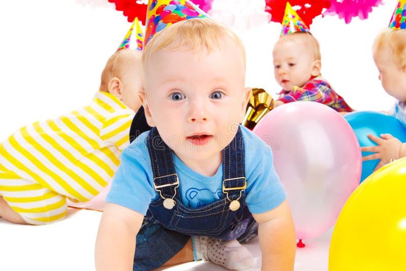 Birthday party. Babies having fun at the birthday party stock photo