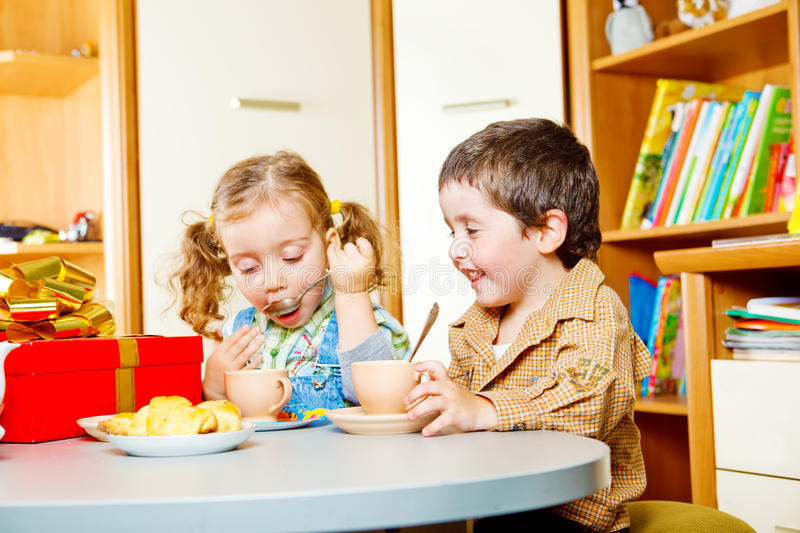 Birthday party. Two kids at the birthday party royalty free stock images