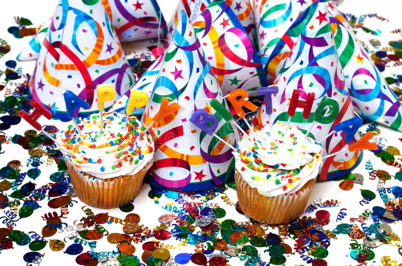 Birthday Party. With cupcakes, candles, hats, and confetti royalty free stock photos