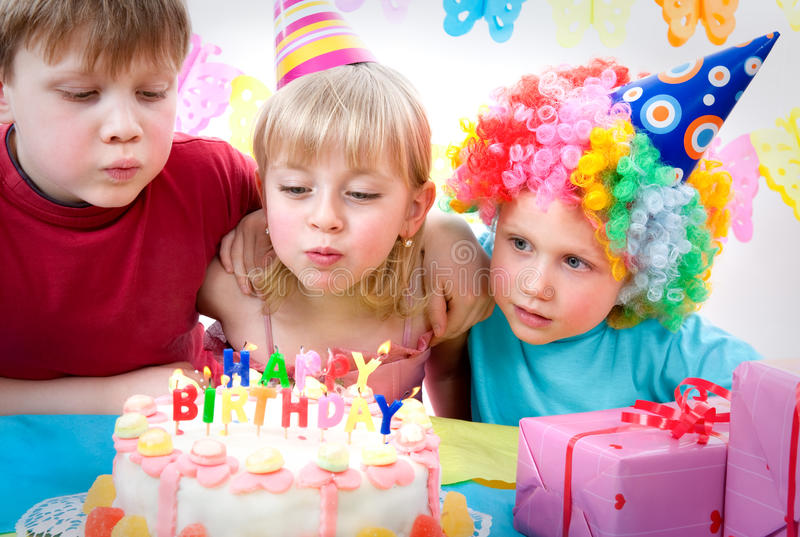 Birthday party. Three kids celebrating birthday party royalty free stock photography