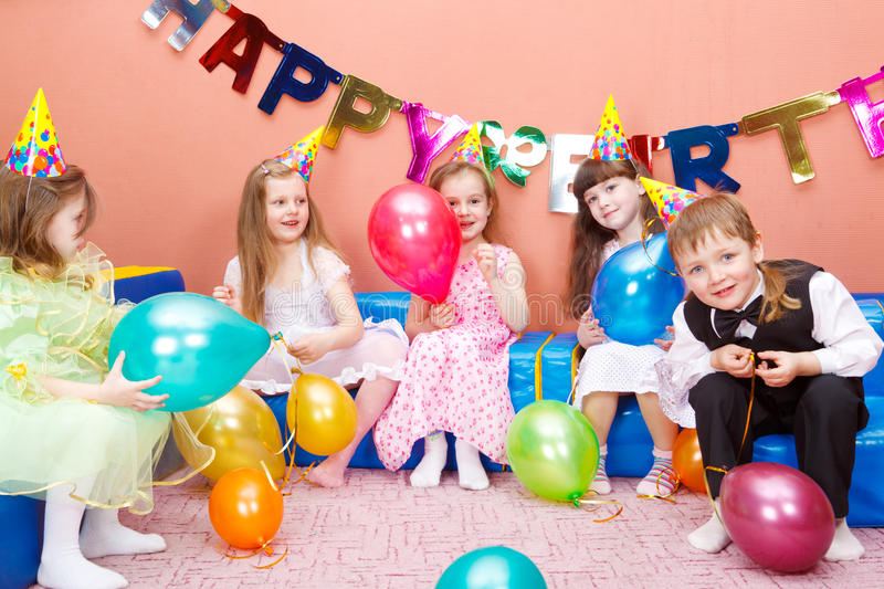 Birthday party. Group of preschool kids at the birthday party royalty free stock photography