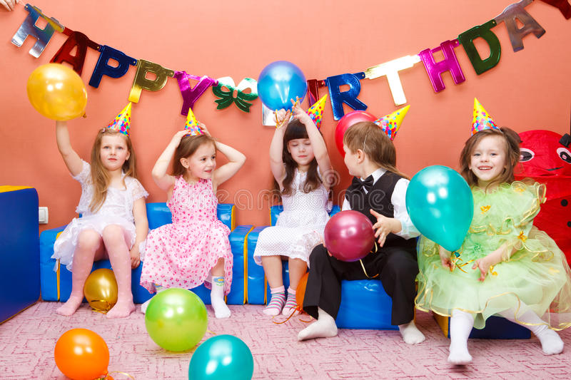 Birthday party. Group of preschool kids at the birthday party royalty free stock photo