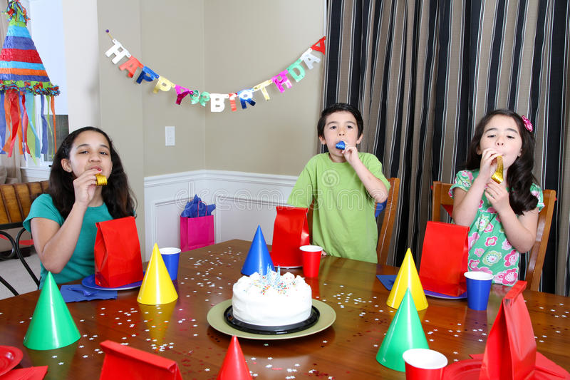 Birthday Party. Group enjoying a birthday party for child royalty free stock photography