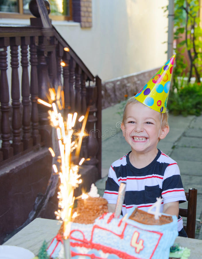 Birthday party. Outdoors birthday party with cake and fireworks candles stock image