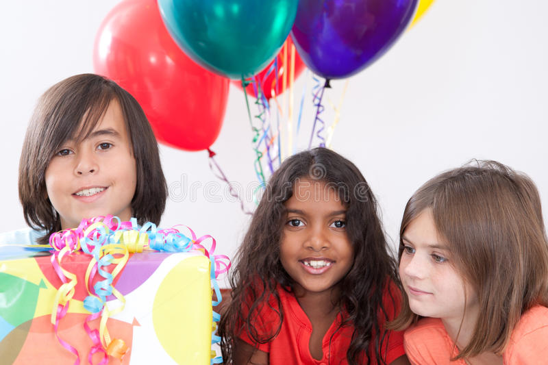Birthday Party. Three multi-ethnic kids at a birthday party stock image