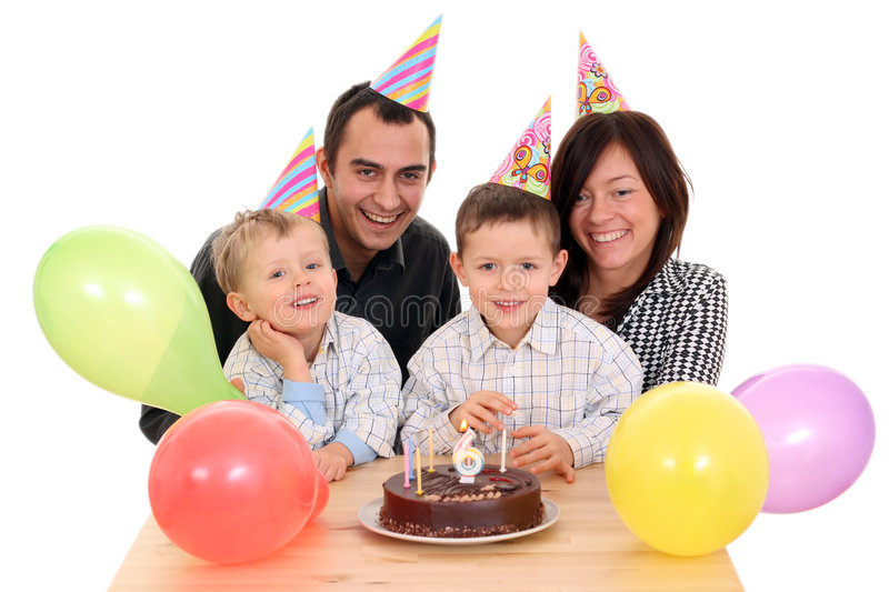 Birthday party. Family celebrate birthday - birthday cake and lots of fun royalty free stock photo