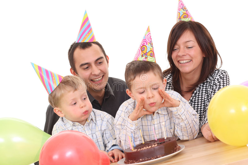 Birthday party. Family celebrate birthday - birthday cake and lots of fun royalty free stock image