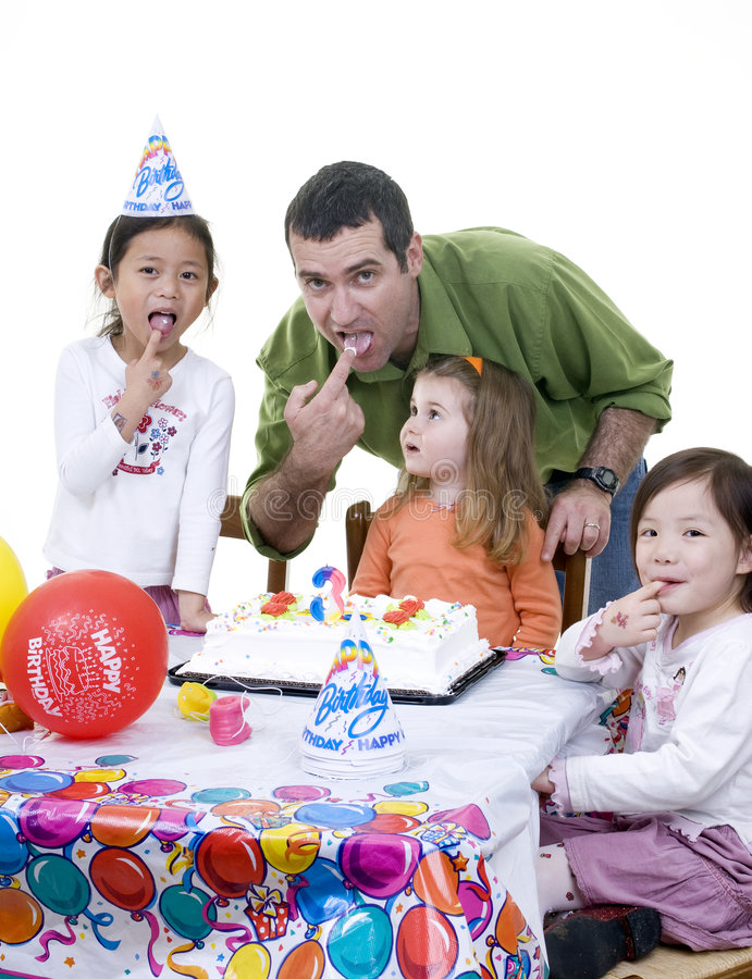 Birthday Party. A group of young children and family celebrate a birthday party stock photo
