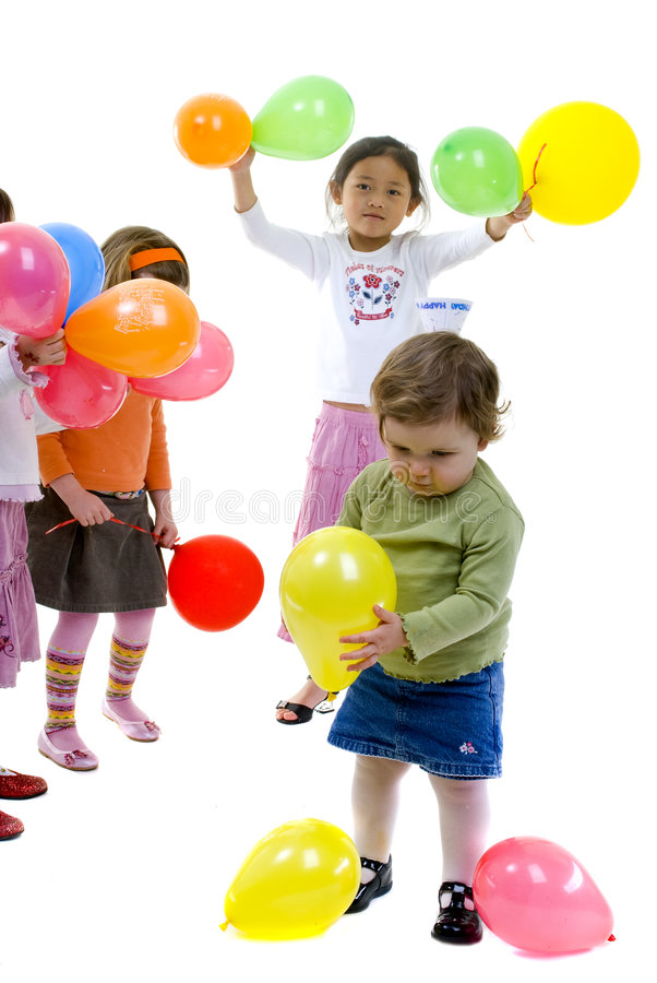 Birthday Party. A group of young children celebrate a birthday party royalty free stock photography