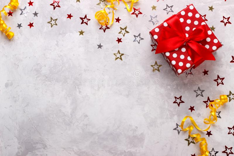 Birthday party background. Border with gift box and confetti royalty free stock image