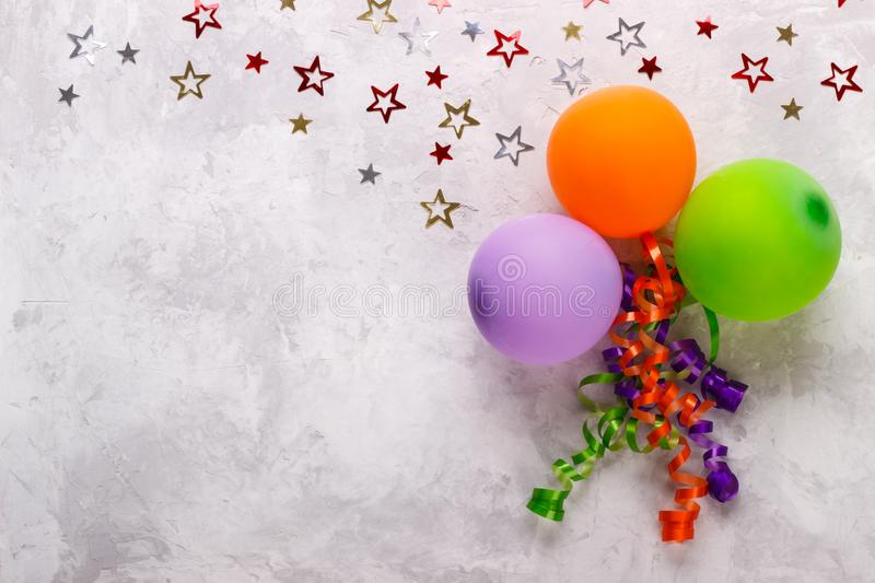 Birthday party background. Border with balloons and confetti stock photos
