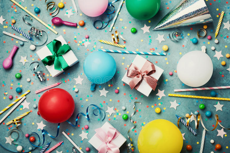 Birthday party background with colorful balloon, gift, confetti, cap, star, candy and streamer. Flat lay style. Festive card. Birthday party background with royalty free stock image