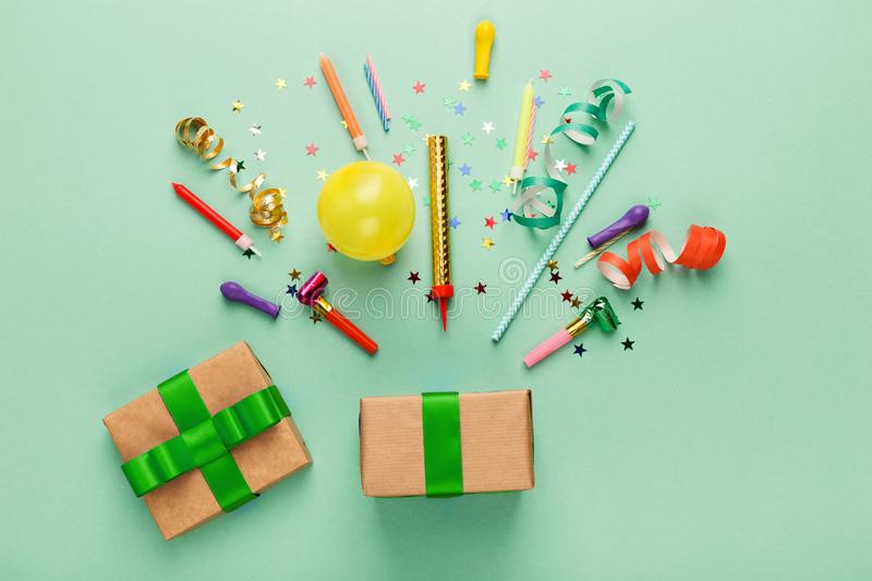 Birthday party background with gift and confetti stock photography