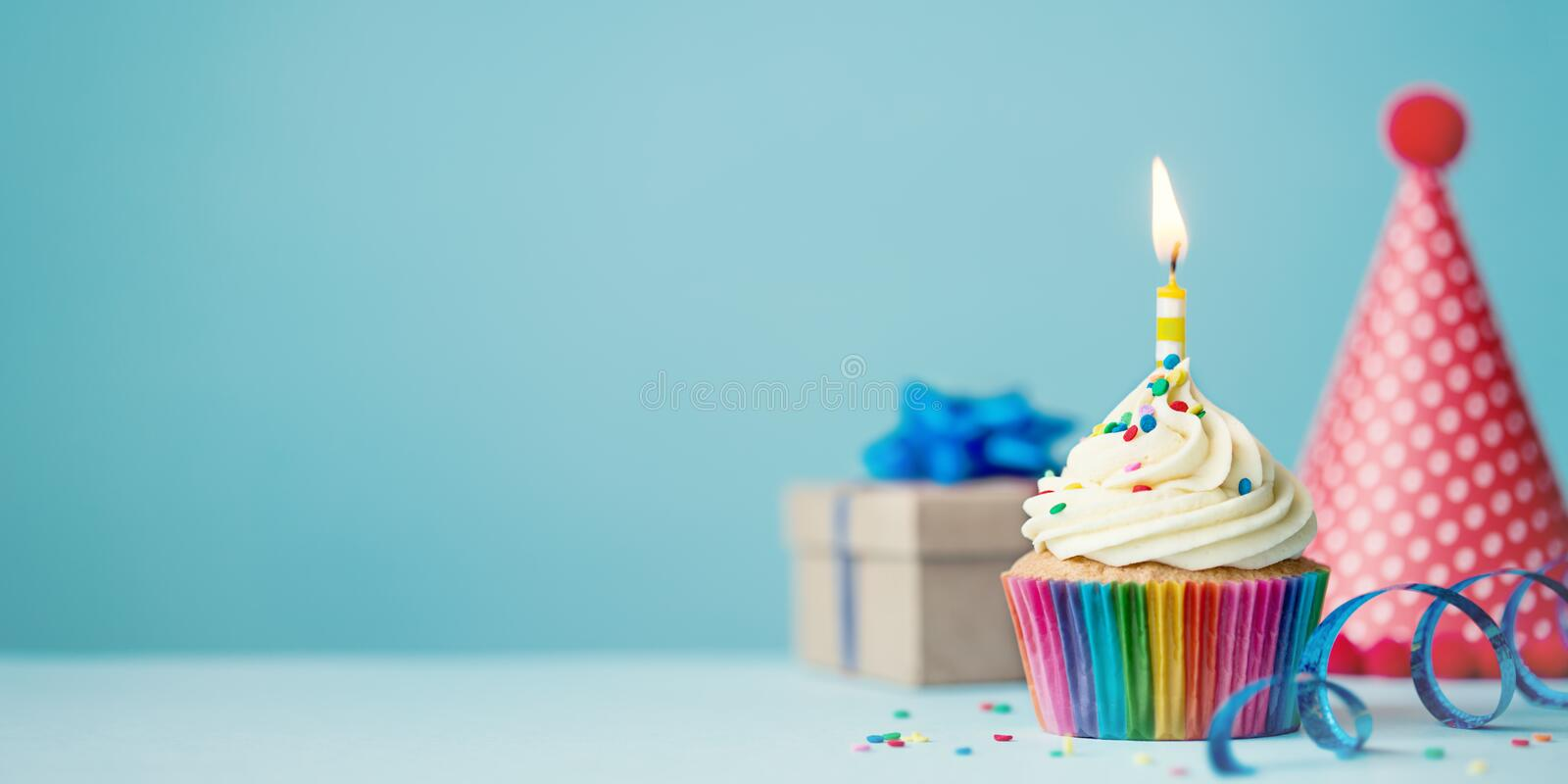 Birthday cupcake with candle royalty free stock image