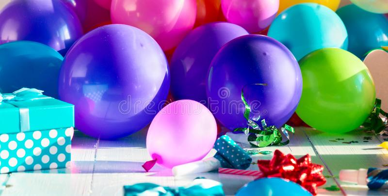 Birthday party background decoration balloon confetti serpentine birthday hat gift boxes royalty free stock image