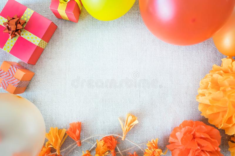 Birthday party background with festive decor, orange, yellow and stock images