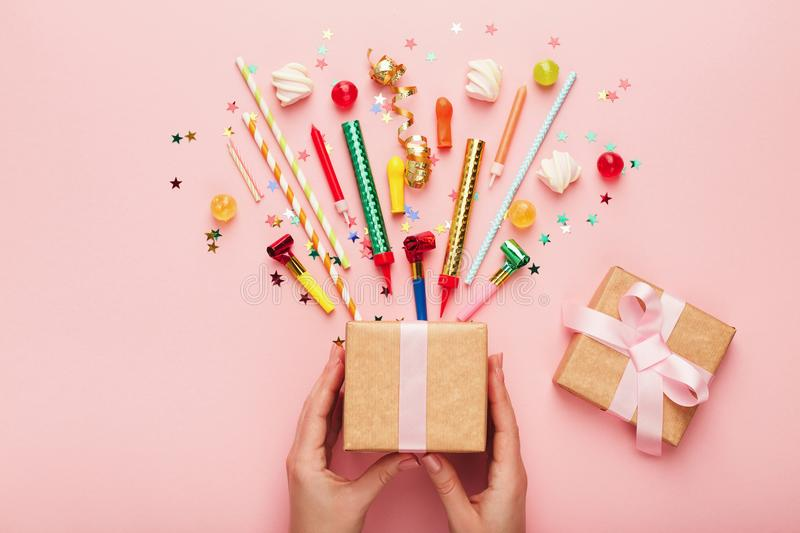 Birthday party background with gift and confetti stock photo