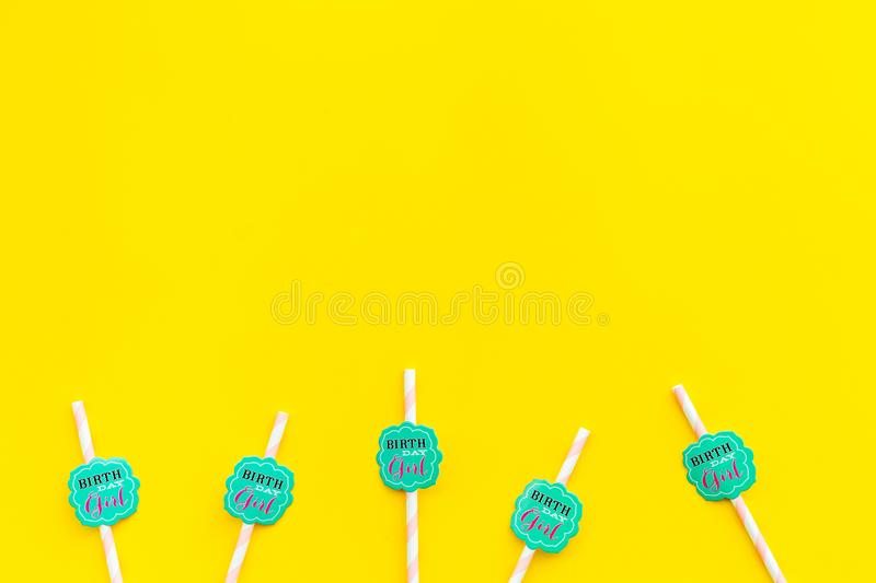Birthday party background. Lettering Birthday girl on drink straws on yellow top view space for text royalty free stock photography