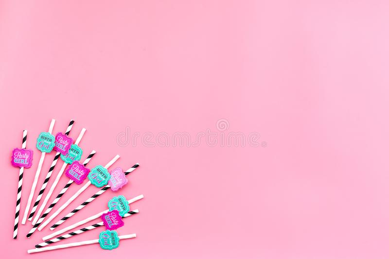 Birthday party background. Lettering Birthday girl and Perty girl on drink straws on pink top view space for text royalty free stock images