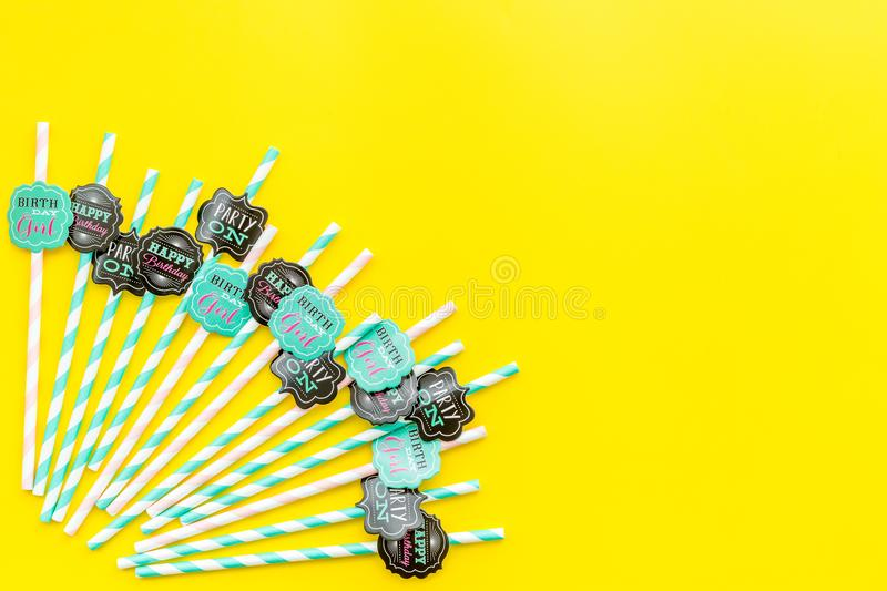 Birthday party background. Lettering Party on and Birthday girl on drink straws on yellow top view copy space stock photography