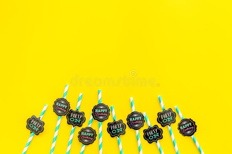 Birthday party background. Lettering Party on and happy birthday on drink straws on yellow top view copy space stock image