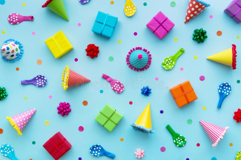 Birthday background on blue. Birthday party background with party hats and birthday gifts royalty free stock image