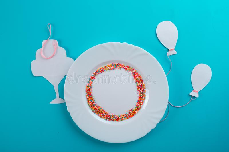 Birthday party background. Plate on blue background royalty free stock photos