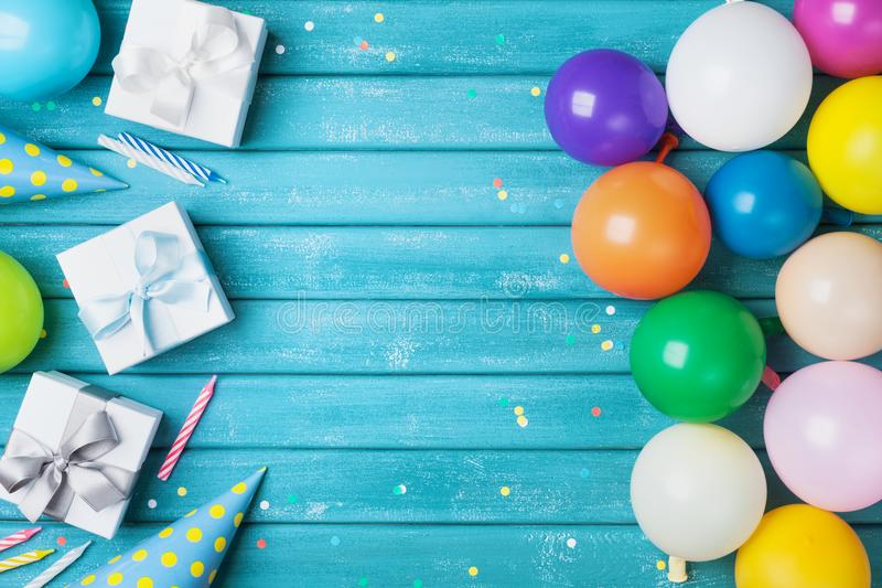 Birthday party banner or background with colorful balloon, gift, carnival cap, confetti and candy. Copy space. Birthday party banner or background with colorful royalty free stock photos