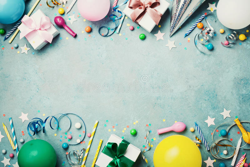 Birthday party banner or background with colorful balloon, gift, carnival cap, confetti, candy and streamer. Flat lay style. Copy space for greeting text royalty free stock photography
