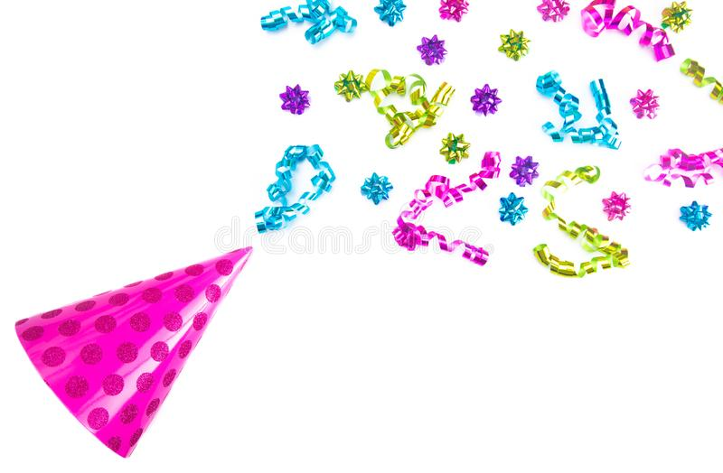 Birthday Party Bows and Ribbons Shooting out of a Pink Party Hat. Birthday Party Bows and Ribbons Shooting out of a Party Hat royalty free stock image