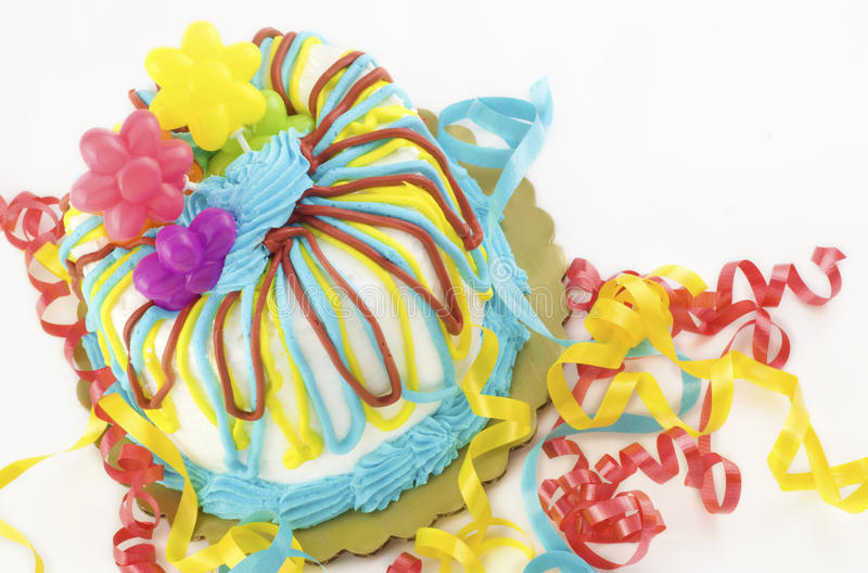 Birthday Party Cake. A colorful birthday cake, isolated on white background with copy space, selective focus, horizontal with diagonal tilt royalty free stock photography