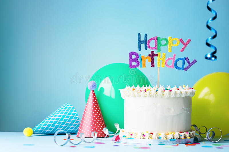 Birthday party and cake. Birthday cake with colorful greeting stock photos