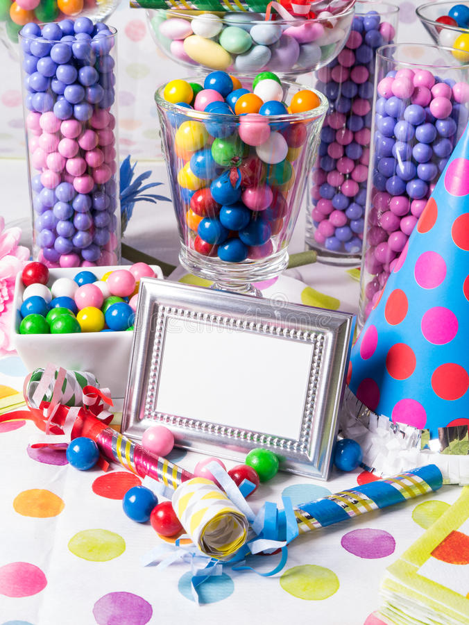 Birthday Party Candy Station Buffet Table. A buffet table full of colorful sweet and tasty candy with blank sign for custom copy stock images