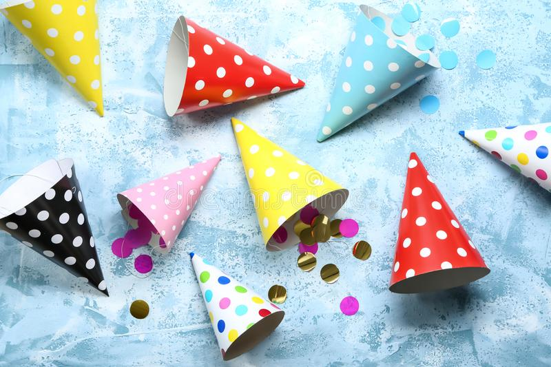 Birthday party caps on color background royalty free stock photo