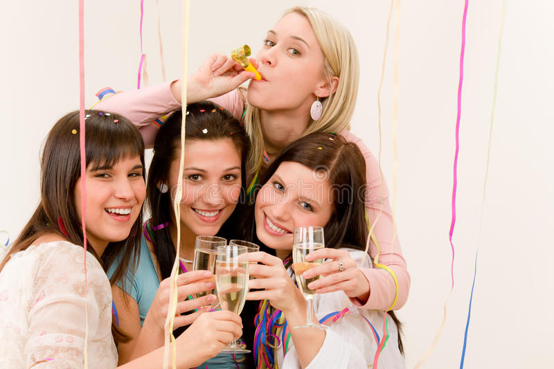 Birthday party celebration - woman with confetti. Birthday party celebration - four woman with confetti have fun with champagne stock photo