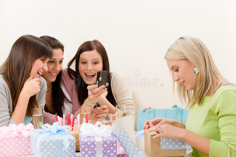 Birthday party - cheerful woman take photo royalty free stock photography