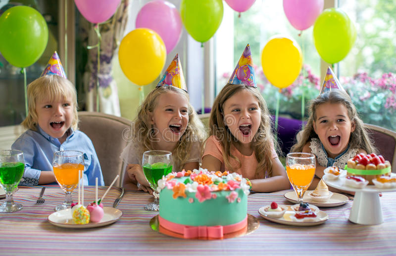 Birthday party. Children at a birthday party at home stock image