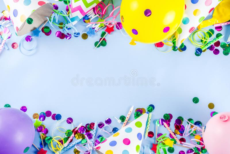 Birthday party background. Birthday party decoration background with balloons, gift boxes, steamers and confetti, trendy light blue table copy space above stock image