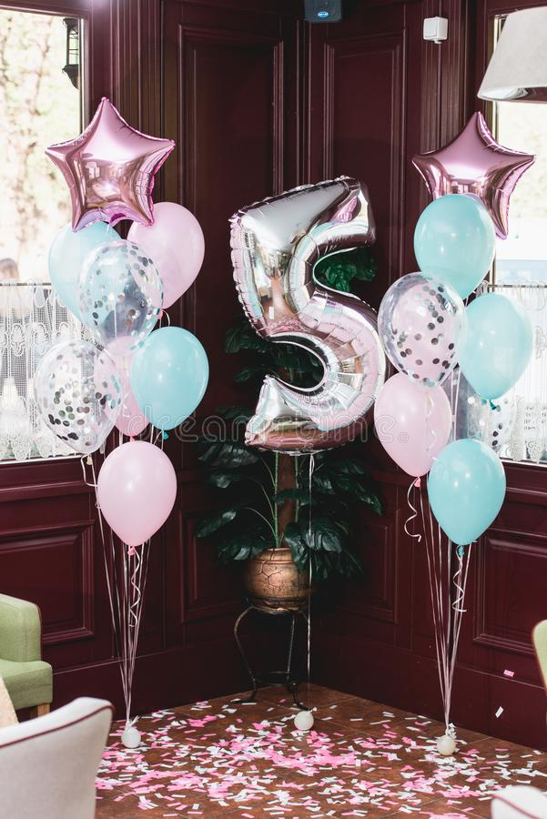 Birthday party decorations indoor with baloons of differen shapes royalty free stock image