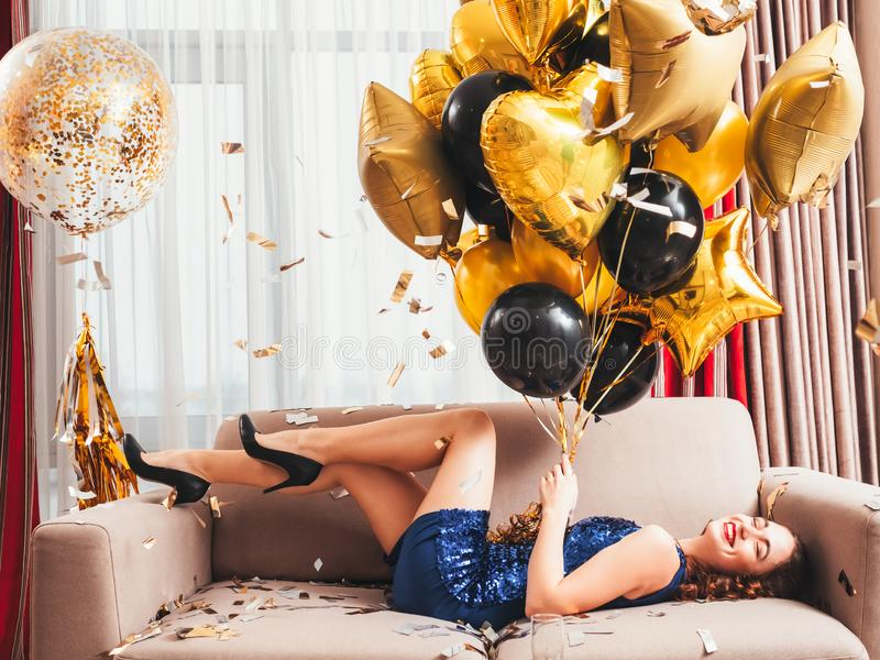 Birthday party delighted smiling lady balloons stock photos