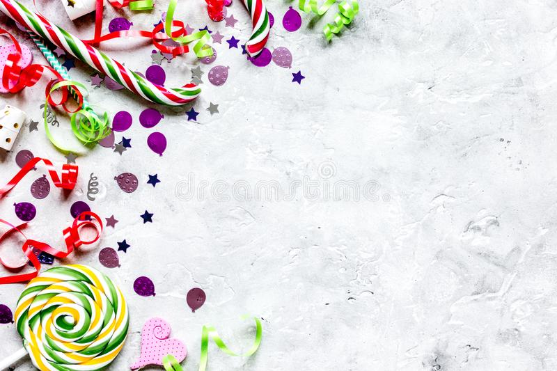 Birthday party design with confetti top view space for text. Birthday party design with colorful confetti on stone table background top view space for text stock image