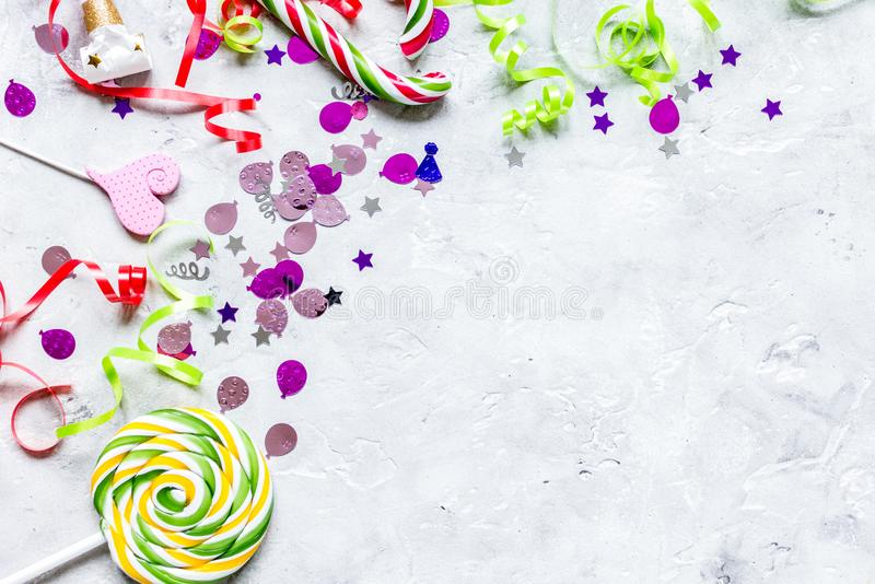 Birthday party design with confetti top view space for text. Birthday party design with colorful confetti on stone table background top view space for text stock photo