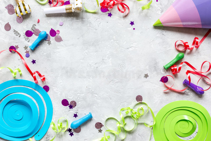 Birthday party design with confetti top view space for text. Birthday party design with colorful confetti on stone table background top view space for text royalty free stock image